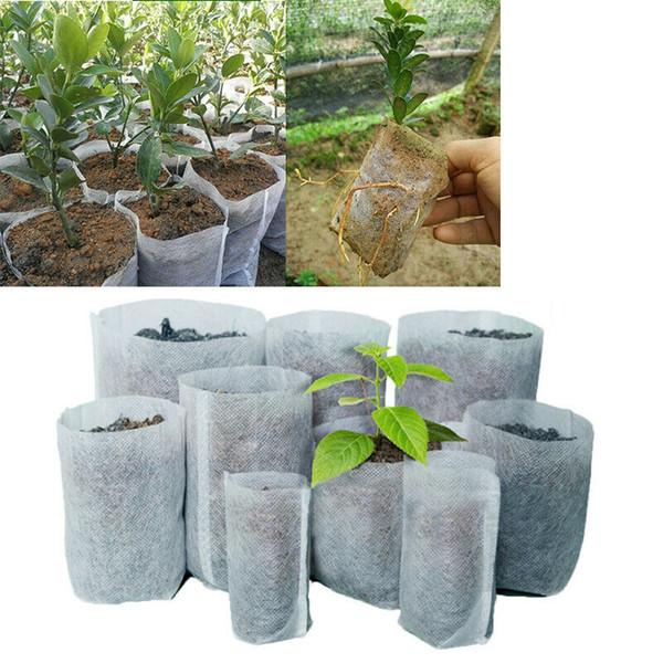 Os potenciômetros não tecidos da tela da árvore crescem o saco 10 malotes da planta do recipiente da raiz do tamanho A mão branca com plantação dos sacos das flores cresce a cultura MMA1962