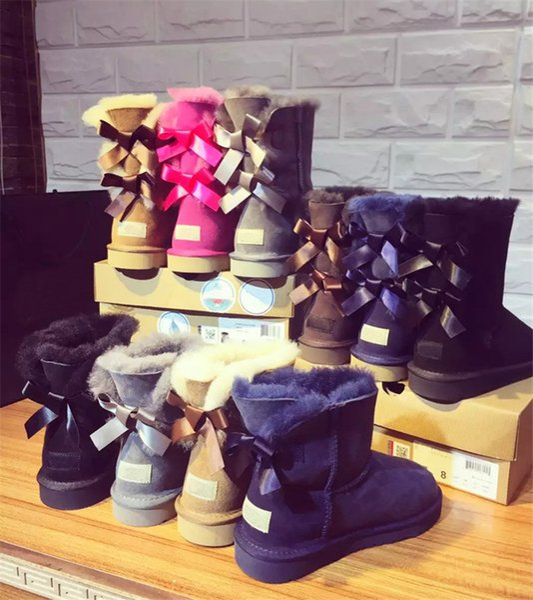 Marca Australia Stivali da neve Designer Mid-leg Ug Donna Uomo Stivali Unisex Inverno Classico Stivali corti Mantieni caldo Bowknot Stivali di lana Scarpe C72208