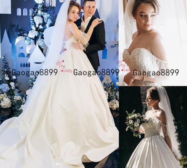 2020 luxe perles robe de bal robe de mariée Princesse jupes bouffantes épaule dentelle de mariée haut tribunal train à voile Robes formelles