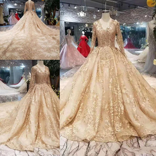Golden Lace Wedding Dresses 2019 Newest Style Champagne V-Neck Long Sleeves Lace Up Back Party Bridal Gowns With Shiny Royal Train