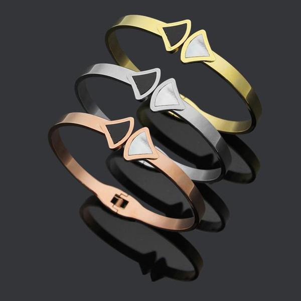 Uphot bracelet bijoux bracelet en acier de titane gros en noir et blanc coquillages accessoires bracelet commerce extérieur en or 18 carats.