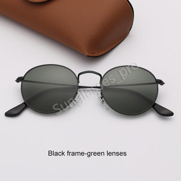 Черная рамка-зеленые линзы