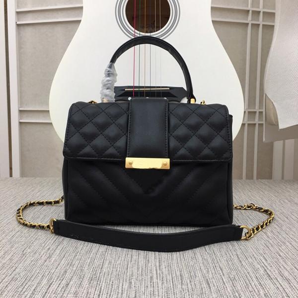 Color negro estilo temperamento cuero de vaca genuino de tamaño mediano con botón a presión de metal adecuado para bolso de señora marca de diseñador de alta calidad