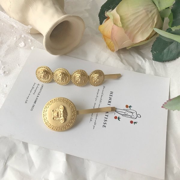 Do old cold breeze beauty head small coin dumb gold hair pin ins same style web celebrity hair ornament word edge clip female