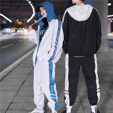 Designer Mens Tute Windbreaker + Pants Sport che fanno funzionare Set College High Street Style Kit vestiti di modo casuale della mutanda del cappotto con QSL198223