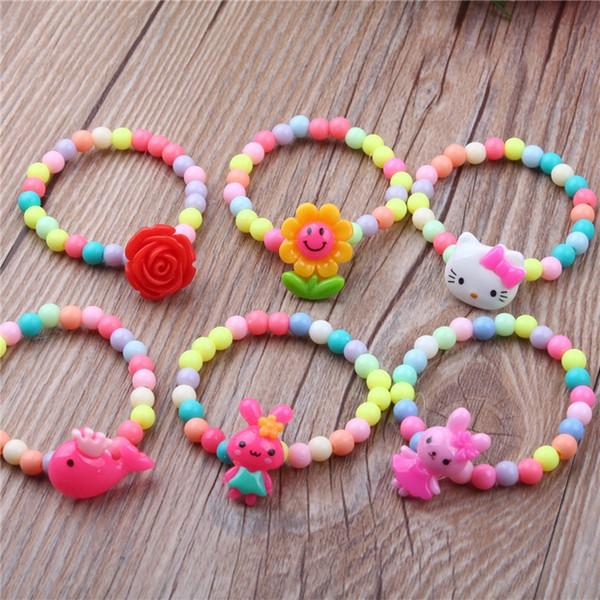 5pcs Enfants Couleur Mélangée Fleur Perles En Bois Charme Bracelets Manchette Bracelet Enfants Garçons Filles Bracelet Bracelet Bijoux De Mode Cadeaux