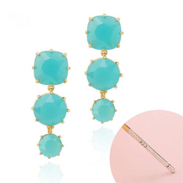 Blau-grüne Ohrringe
