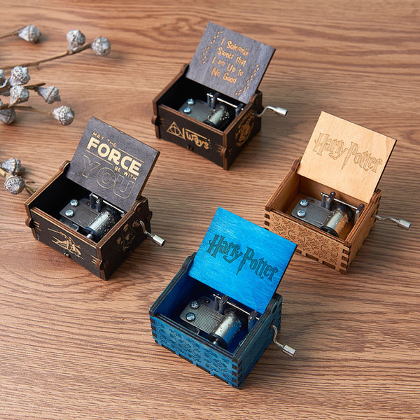 top popular Creative Classic wooden Music Box All kinds pictures Ingraved Hand Shaking motivated Harry Poters Ornaments Music Box 2021
