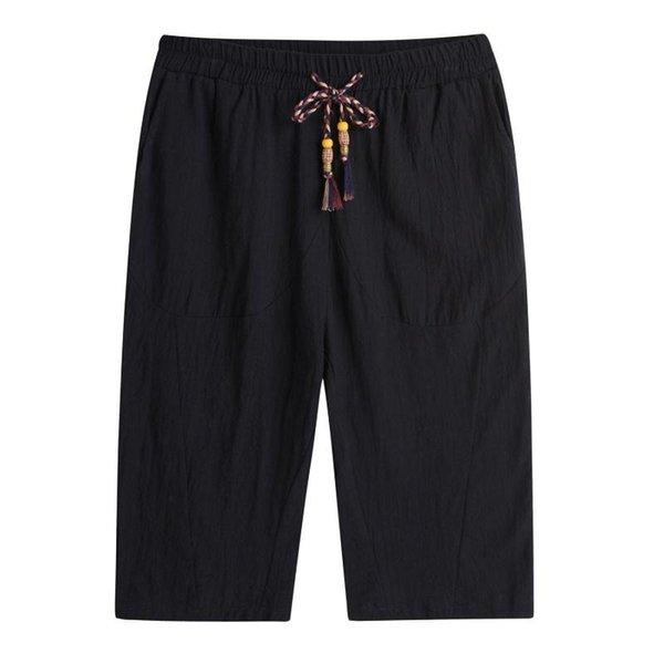 Pantaloni tagliati neri