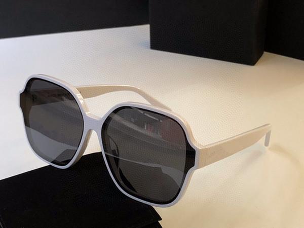 lente gris marco blanco