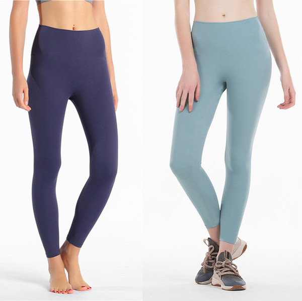top popular Women Yoga Pants High Waist Sports Gym Wear Solid Color Breathable Stretch Tight Pants Skinny Leggings Womens Athletic Joggers Pants 2020