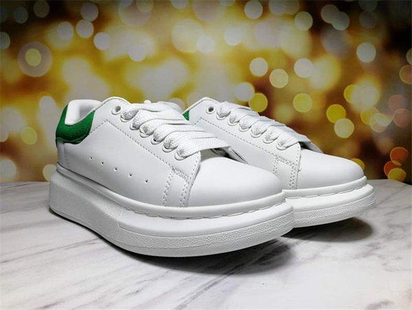 sapatos brancos cauda verde