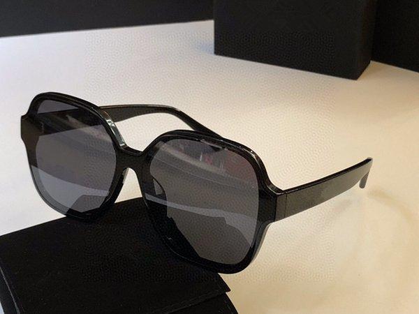 lente gris marco negro