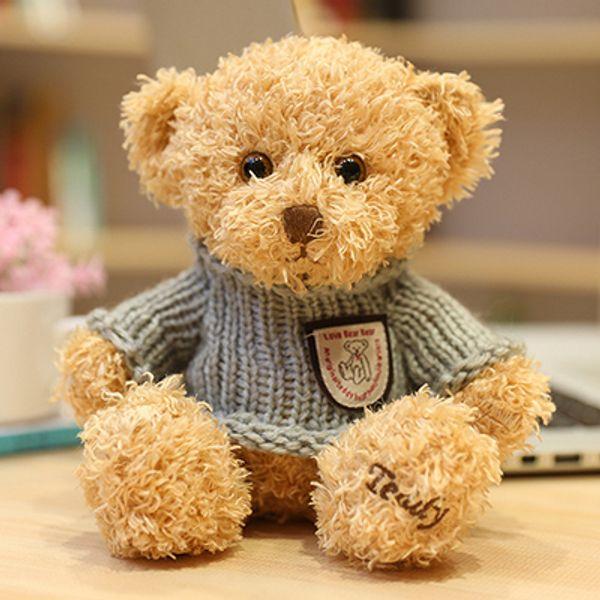 Light brown grey sweater bear