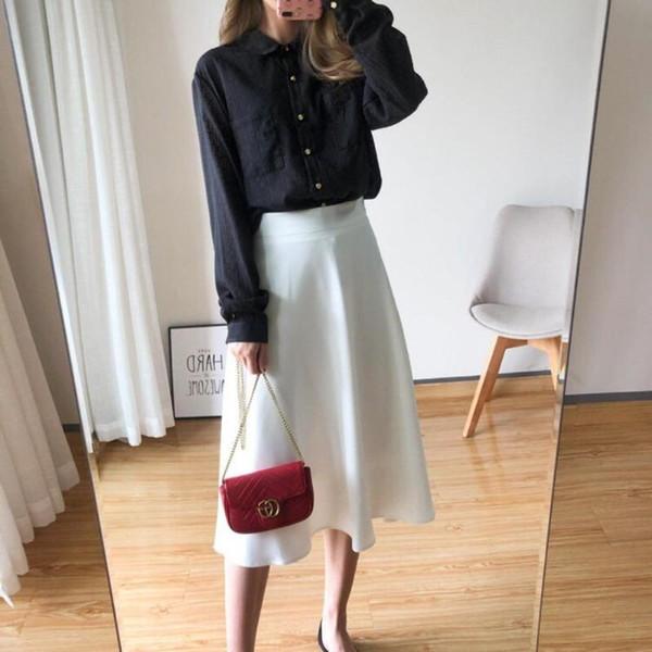 Una blusa negra