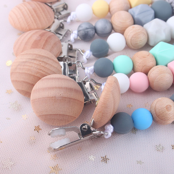 top popular Fashion Silicone Baby Pacifier Clip Wood Beaded Holder Clips Anti Dropping Chain Appease Maternal And Infant Products 5bq D2 2021