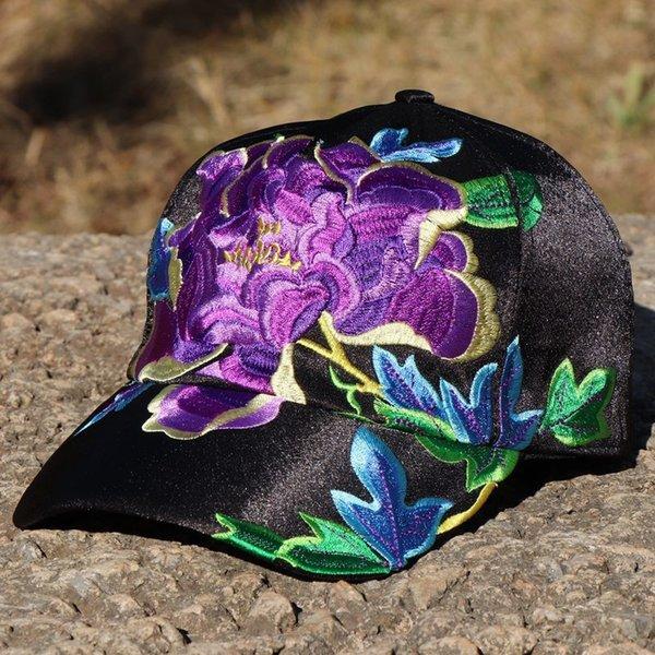 fleur pourpre noir (Pivoine)