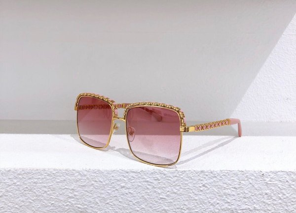 quadro ouro perna-de-rosa lentes cor de rosa