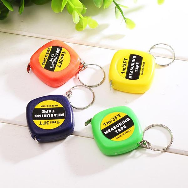 top popular Mini Portable Pull Ruler Keychain 1m 3ft Easy Retractable Measure Ruler Tape Children Height RulerColor Random DLH452 2021