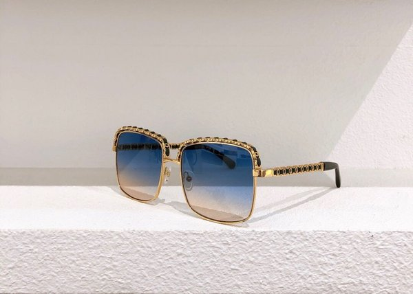 Gold frame black leg blue lenses