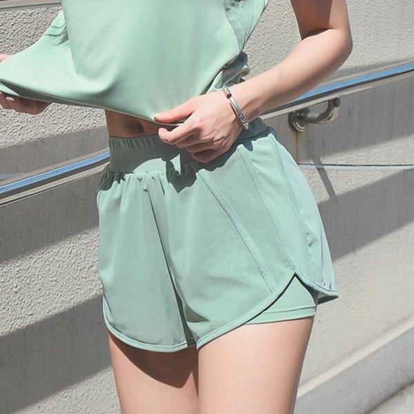 Pantalones cortos de deportes verdes