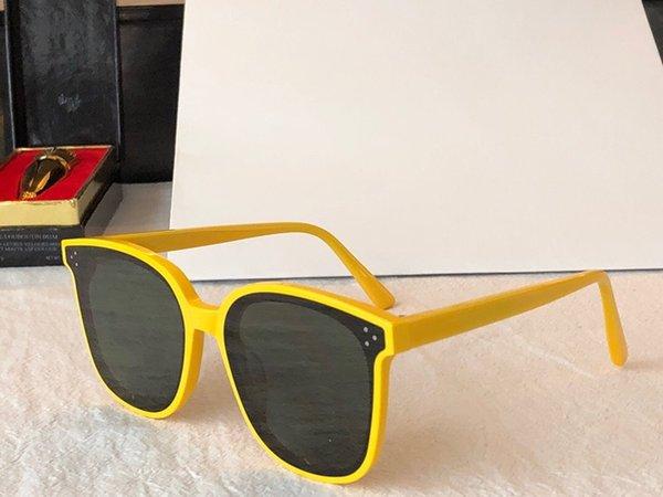 cadre jaune lentille grise