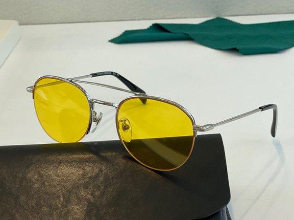 серебряная рамка желтые линзы