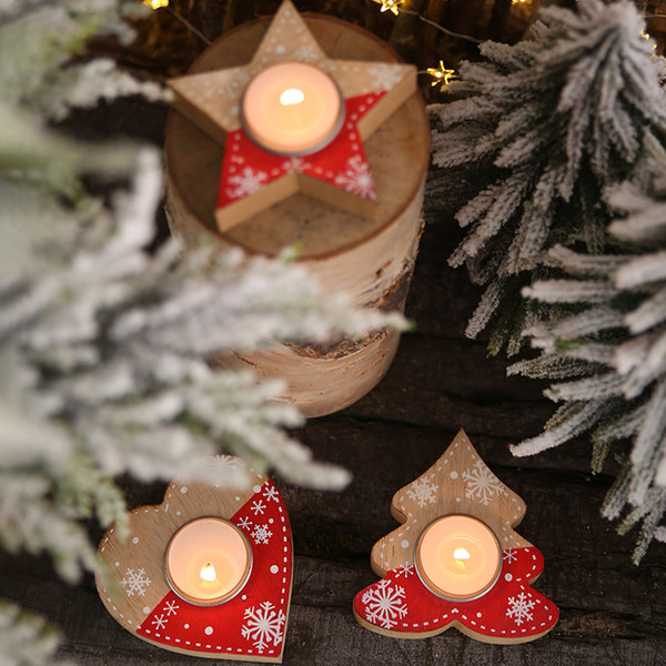 top popular Christmas Candle Holder Creative Heart Shaped Wooden Candlestick Christmas Desktop Decoration New Year Craft Festival Party Supplies 2021