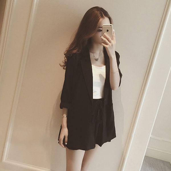 Traje negro + blanco Sling