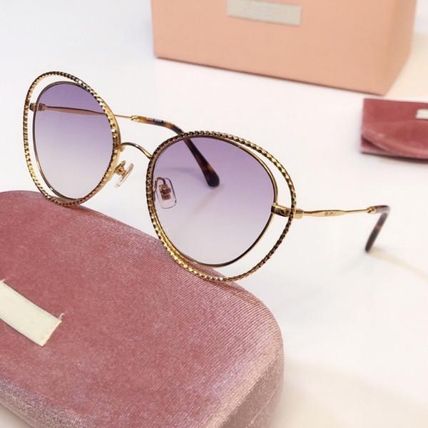 Gold frame purple optic