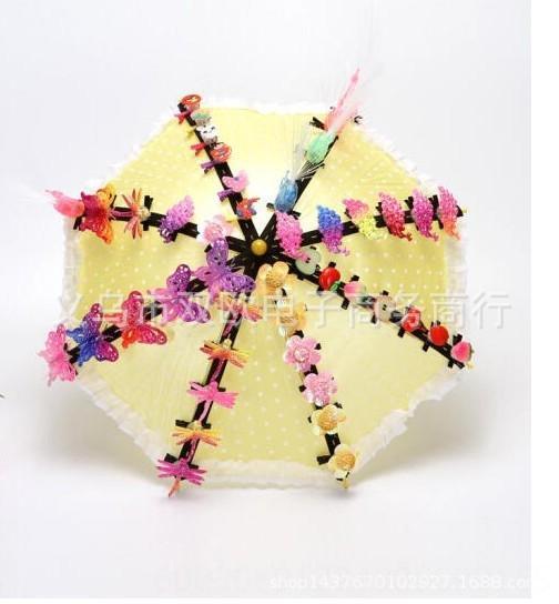 Paraguas amarillo con 50 de las horquillas