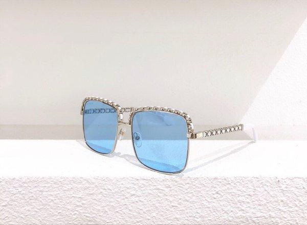 Frame de prata perna branca lentes azuis