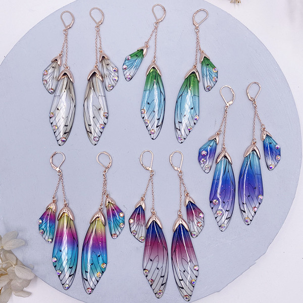 top popular Nina Temperament Long Butterfly Crystal Ear Stud Female Cool Flap Wings Gradient Color Fresh Earrings Manufacturers Hot Sale Moq1 2021