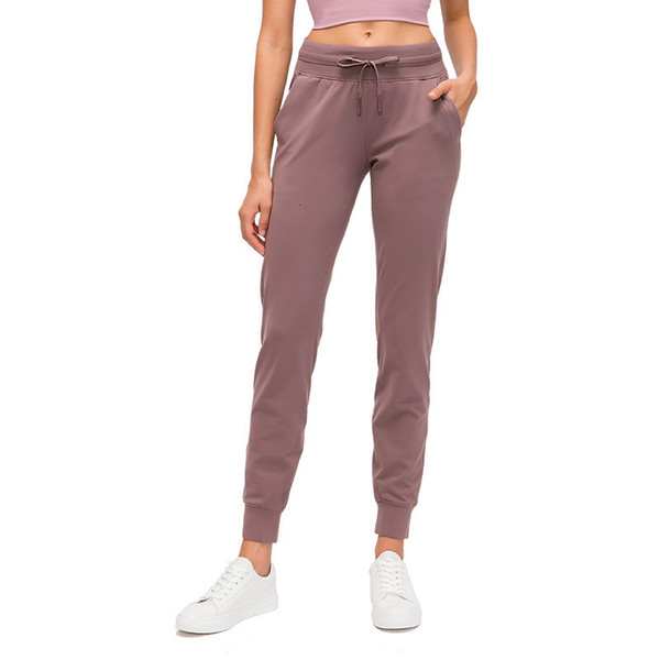 top popular L-89 Spandex Yoga Jogger Pants Push Up Sports Women Fitness Tights with Pocket Femme High Waist Legins Joga Dropshipping naked workout 2020