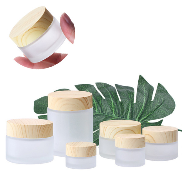 top popular Frosted Glass Jar Cream Bottles Round Cosmetic Jars Hand Face Packing Bottles 5g 50g Jars With Wood Grain Cover 2021