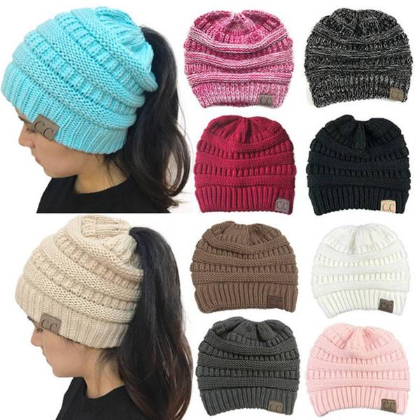 top popular CC Ponytail Caps CC Knitted Beanie Fashion Girls Winter Warm Hat Back Hole Pony Tail Autumn Crochet Hats 15 Colors Big Kids Hats 30pcs 2020