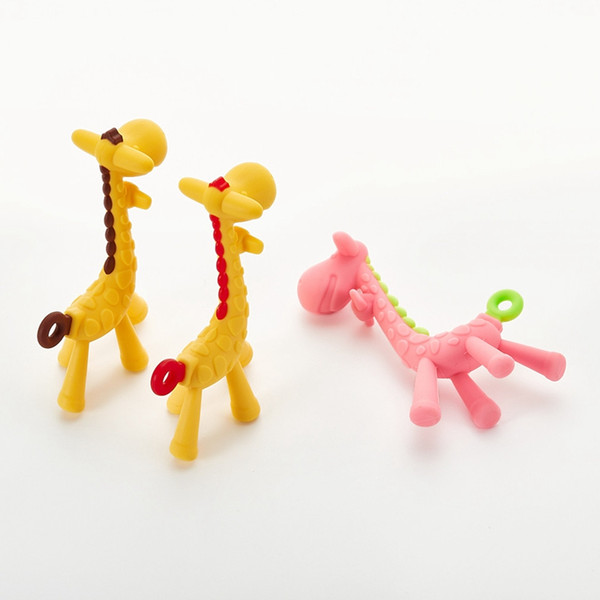 top popular 3 Colors Food Silicone Baby Teethers Toys Cute Giraffe Teething Ring Silicone Chew Dental Care Teethers Toys Gift For Baby Infant DHL 2020