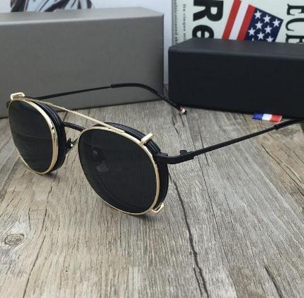 black frame gold gray lens