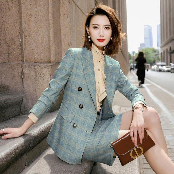 Green coat and skirt