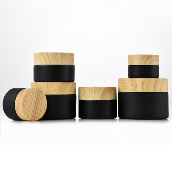 best selling Wholesale Black Frosted Glass Jars Cosmetic Jars With Woodgrain Plastic lids PP liner 5G 10G 15G 20G 30G 50G lip Packing Bottles