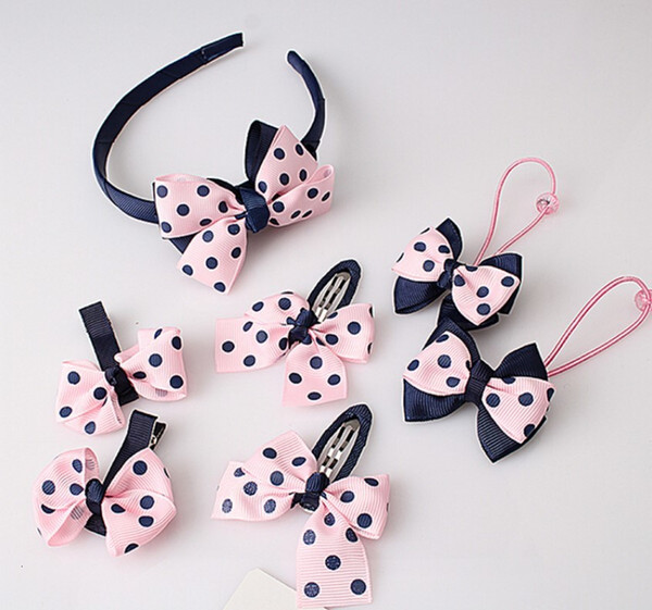 top popular Children's 7-piece set ornaments headgear baby Headband Bow tie hairpin girl hair rope 2021