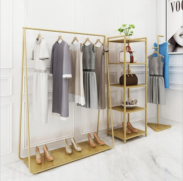 best selling Clothing store display rack floor type combination gold women's clothing store shelf middle island display rack clothes racks