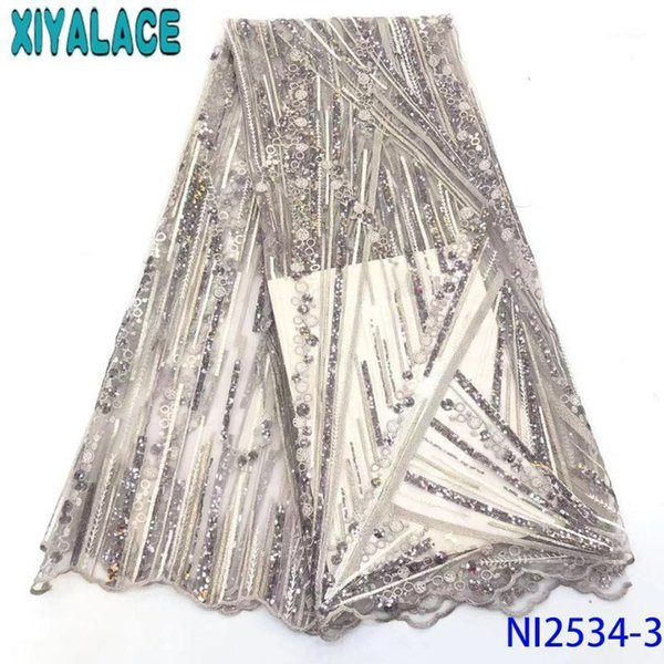 top popular 2020 Latest French Nigerian Laces Fabrics High Quality Tulle Lace Fabric African Net Lace with Sequins KSNI25341 2021