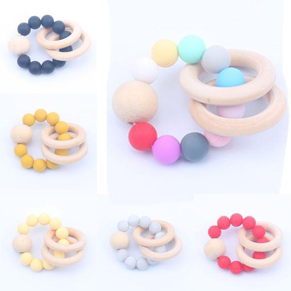 top popular Baby Natural Wooden Teethers Toys Silicone Teether Rattle Baby Heath Accessories Infant Fingers Exercise Colorful Teething Ring Play Toys 04 2020