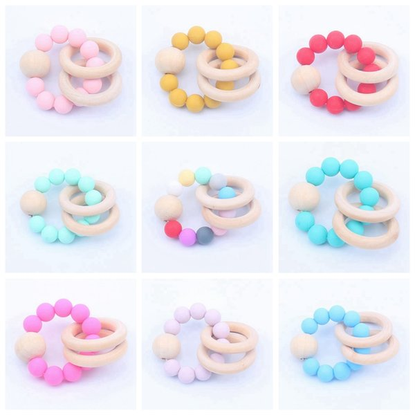 best selling Baby Wooden Teethers Infant Silicone Chew Nursing Bracelets Baby Rattle Stroller Accessories Newborn Teething Ring Toys 16 Colors BT5975