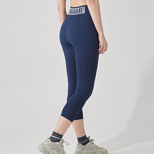 top popular New Yoga Capris Peach Hip Breathable Sports High Waist Tight Stretch Running Fitness Pants for Women 2021