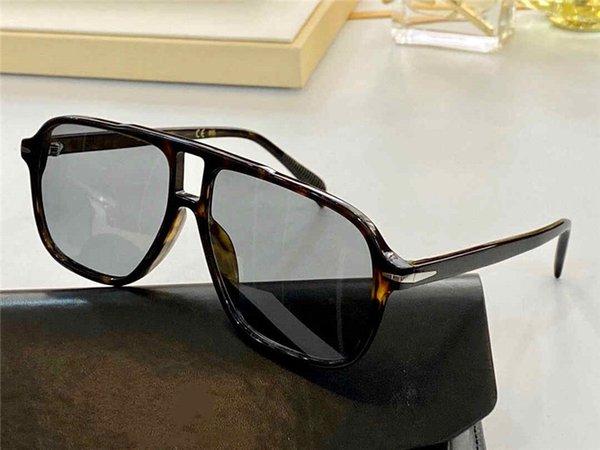 Amber frame light gray lenses