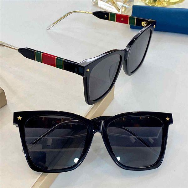 black frame green red les grey lens