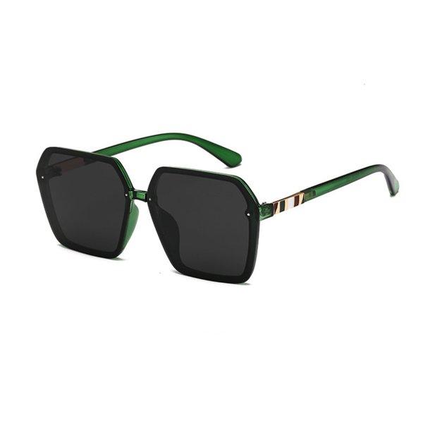 Grüner Rahmen und schwarze graue Scheibe