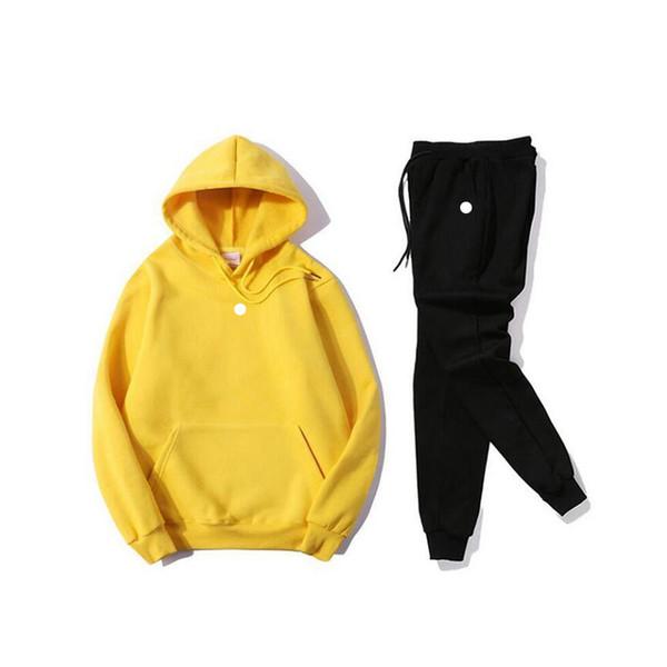 q whitelogo amarillo